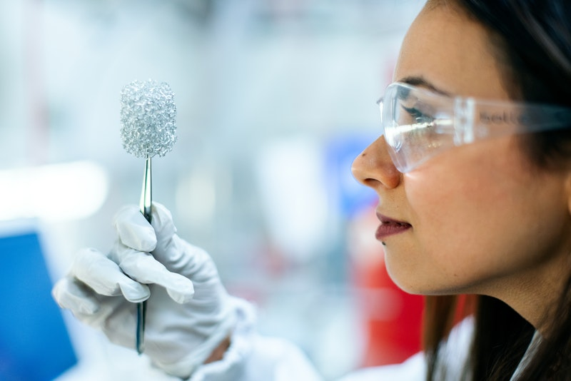 A female engineer looking at a clean energy battery