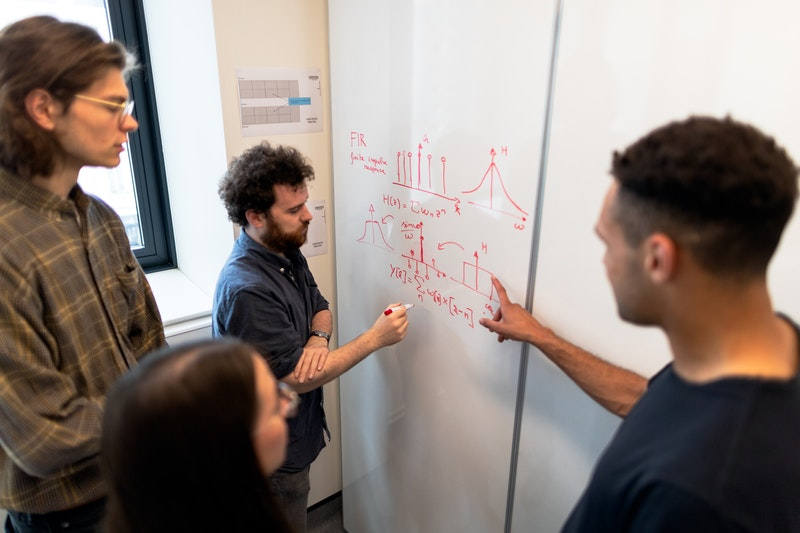 Engineers working on a whiteboard